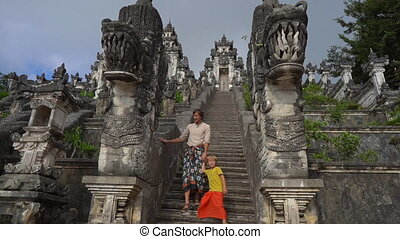 Slowmotion shot of a tourists father and son visiting the Pura Lempuyang Temple at the Bali island, Indonesia.