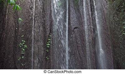 slowmotion shot of a waterfall hidden in jungles. Area...