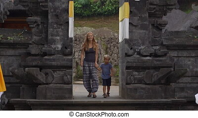 Slowmotion shot of a young woman and her little son visiting...