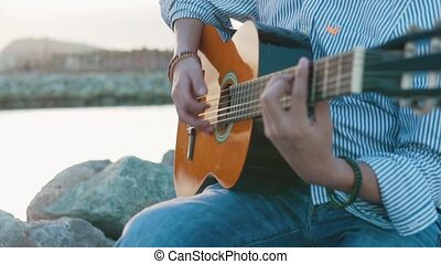 slowmotion shot of of musician man playing acoustic guitar