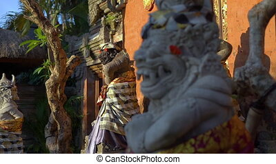 Slowmotion shot of stone statues inside of the Puri Saren...