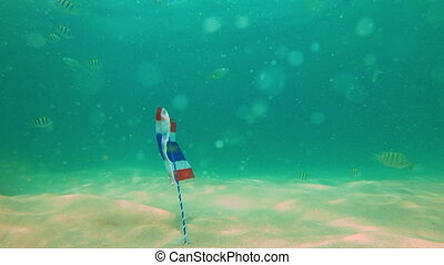 Slowmotion shot of the flag of Thailand underwater in a...
