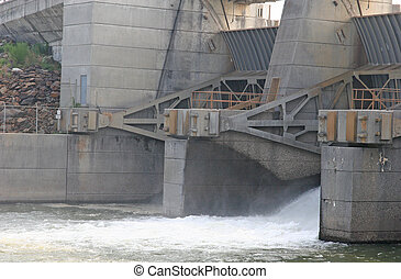 A sluice gate into letting water through a dam