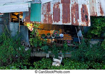 Slum along a canal in Bangkok