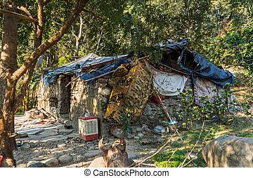 Slum house near the river, Goa, India. The ascetic hut of a hermit, a sadhu. Babba's house.