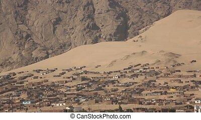 Slum in the desert in Trujillo in Peru - Video footage of...
