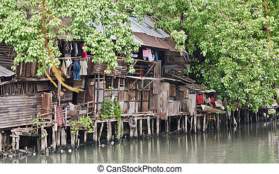 Slum on dirty canal