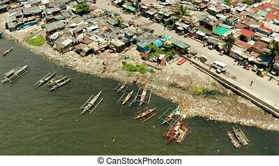 Slums and poor district of the city of Manila. - Slums in...