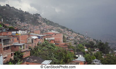 Slums of Medellin passing by seen from a cable car