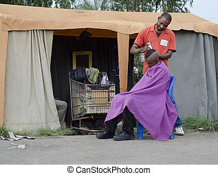 Small African Haircut Barber Business man cutting hair
