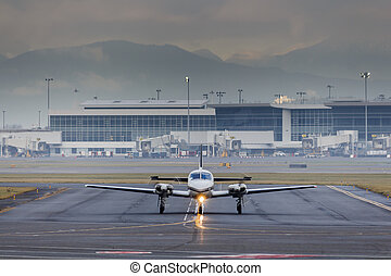 Small Aircraft Taxiing at Airport