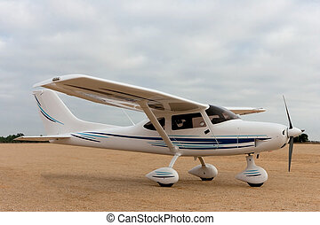 Small airplane in dirt airfield