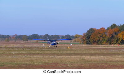Small airplane with a rotating propeller is moving along a...
