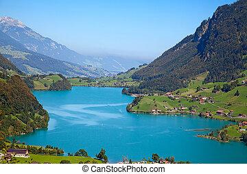 """Small alpine lake """"Lungernsee"""" near Luzern in Switzerland"""