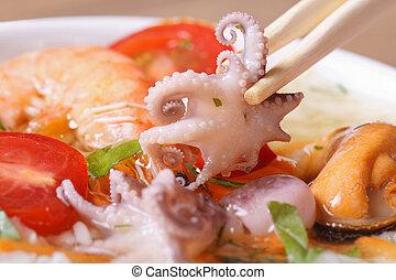 small an octopus hold chopsticks macro