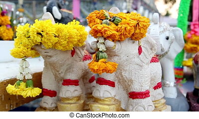 Small animal dolls in front of Buddha statue