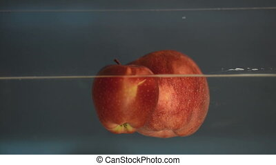Small apple in see trough water closeup