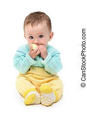 small baby biting apple