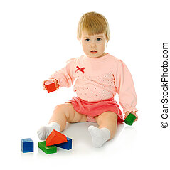Small baby with a toy pyramid isolated