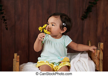 Small baby with flowers
