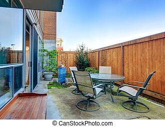 Small backyard area with patio table set