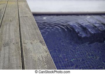Small backyard with small swimming pool spa