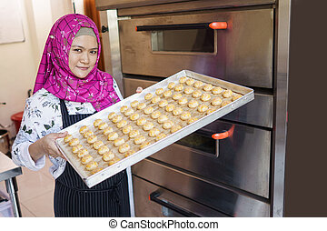 small bakery business owner with her pastry