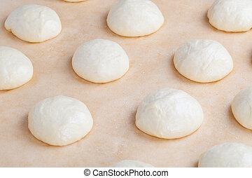 Small balls of fresh homemade pizza dough - Small balls of...