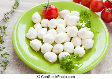 small balls of mozzarella on a plate