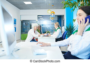 Small bank office with managers at work