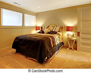 Small basement bedroom with guest bed.