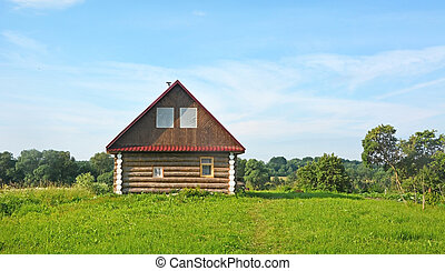 Small bath house on the hill at summer day