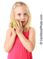Small beautiful smiling child with a green apple. Isolated on white background