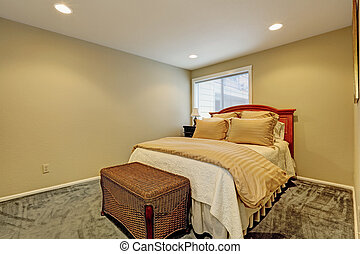 Small bedroom interior with bed and wicker ottoman - Small...