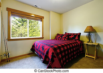 Small bedroom of a man with black and red bedding