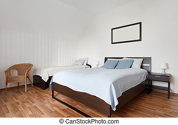 Small bedroom with two beds