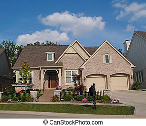 Small Beige Brick Home - Small beige brick home with a two ...