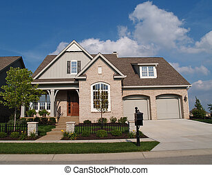Small Beige Brick Home - Small beige brick home with a two...