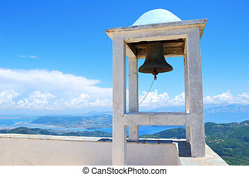 Small belfry with an old bell watching over the island of Lefkad