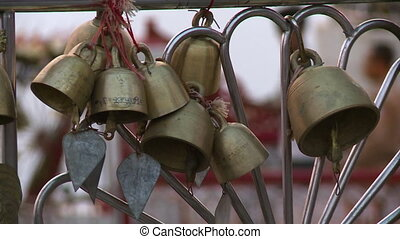 Small Bells Hanging on Steel Beams - Steady, close up,...