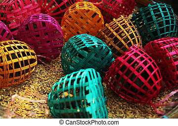small birds in colourful cages