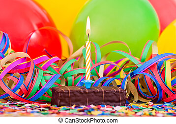 small birthday cake - a burning candle on a small cake with...