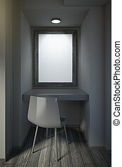 Small black office with blank frame on wall