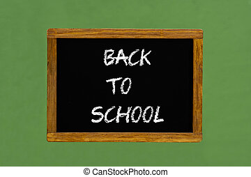 "small blackboard with text ""back to school"""