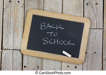 Small blackboard with white chalk
