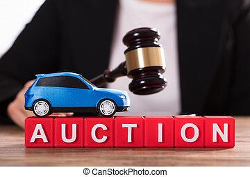 Car Over Auction Cubic Blocks