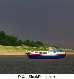 Small blue passenger ship moored at Baltic sea bay