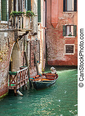 Small boat at old house in Venice