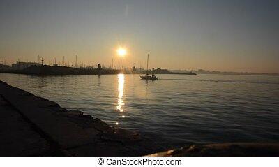 Small boat back to port of Rimini