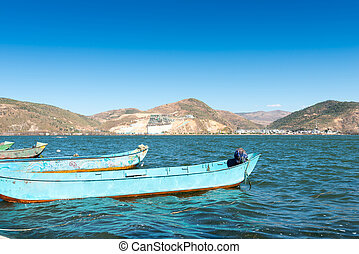 Small boat in lake in mountain